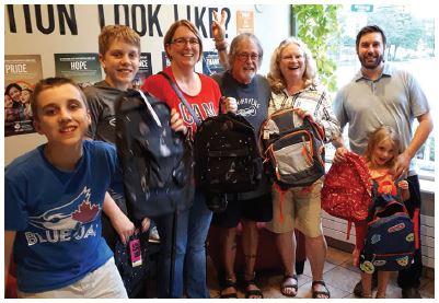 Backpack drive volunteers