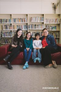 Jayce, Nadine and Chase reading program participants and Alixandra program volunteer