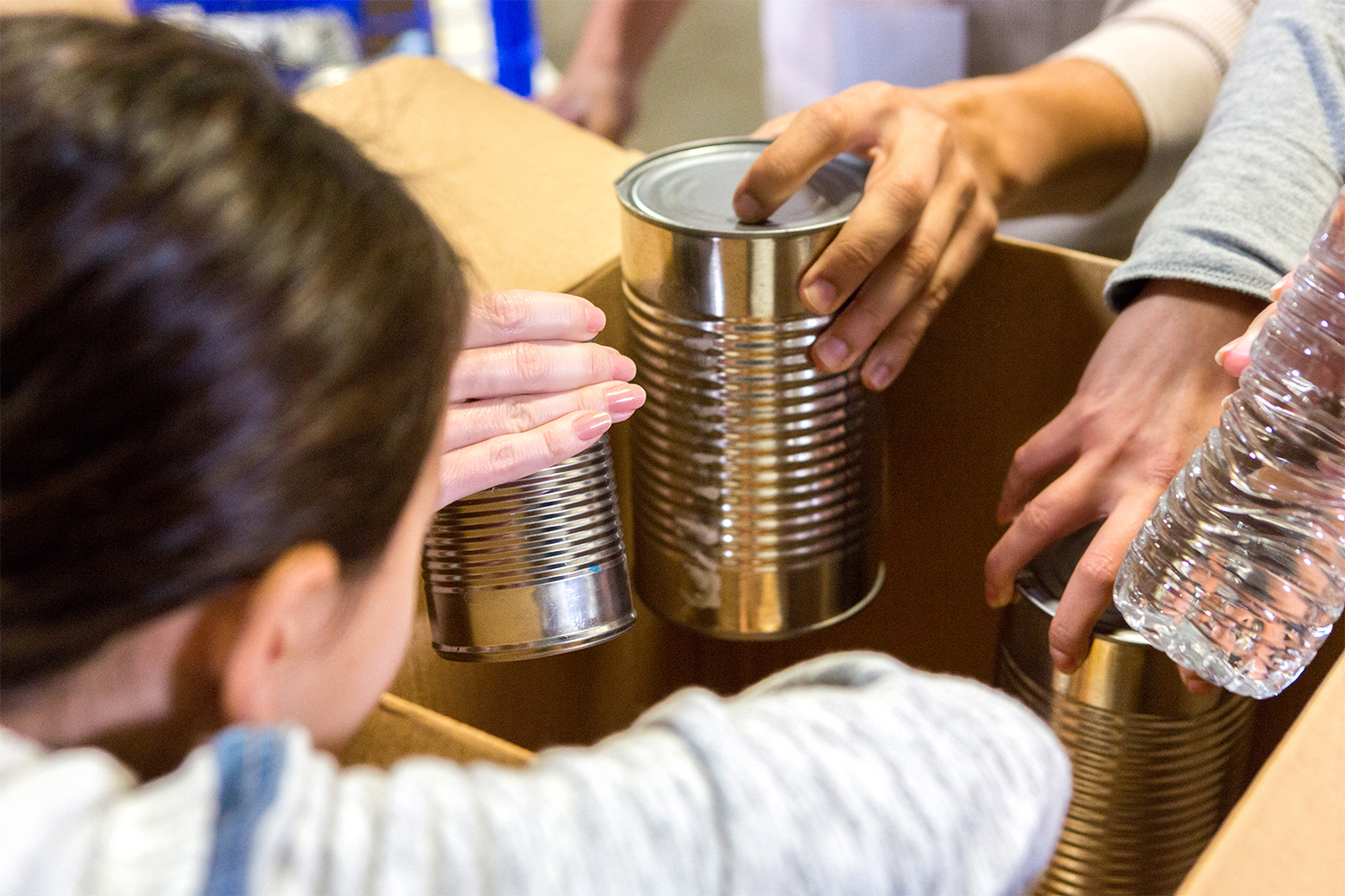 Agency stocking boxes with canned goods