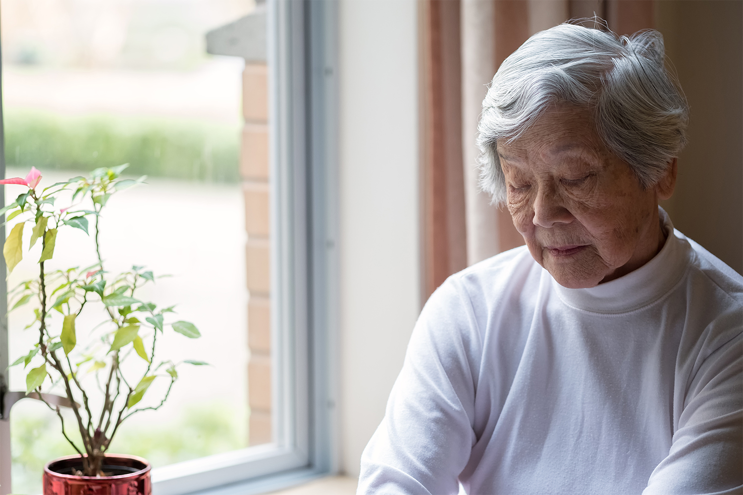 Older woman doing dishes at home