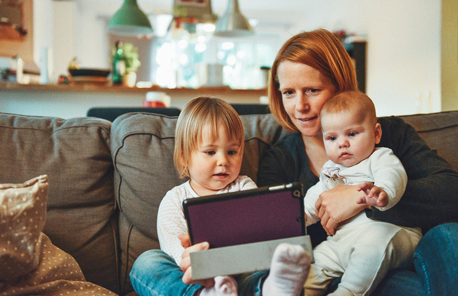 mom with two kids on tablet