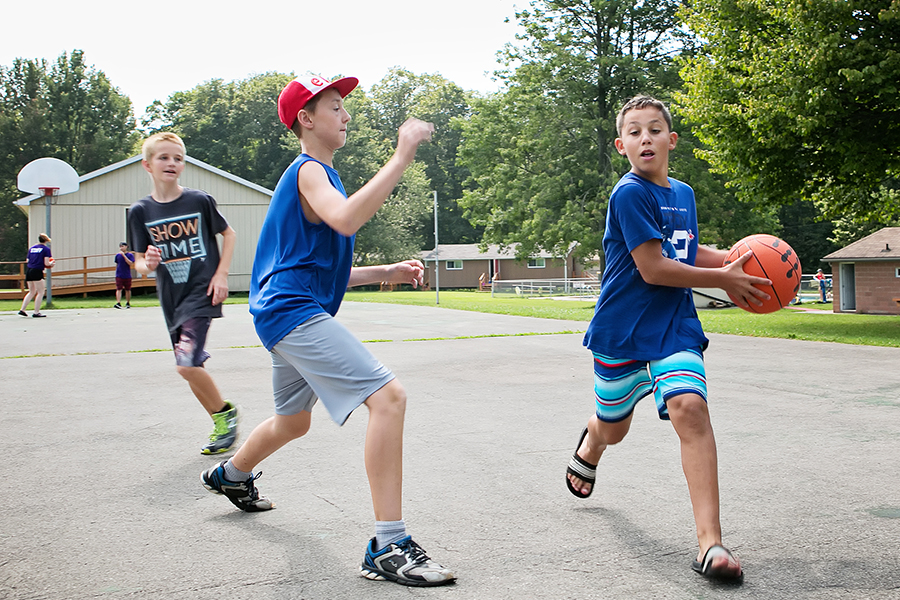 Kids at camp, playing basketball