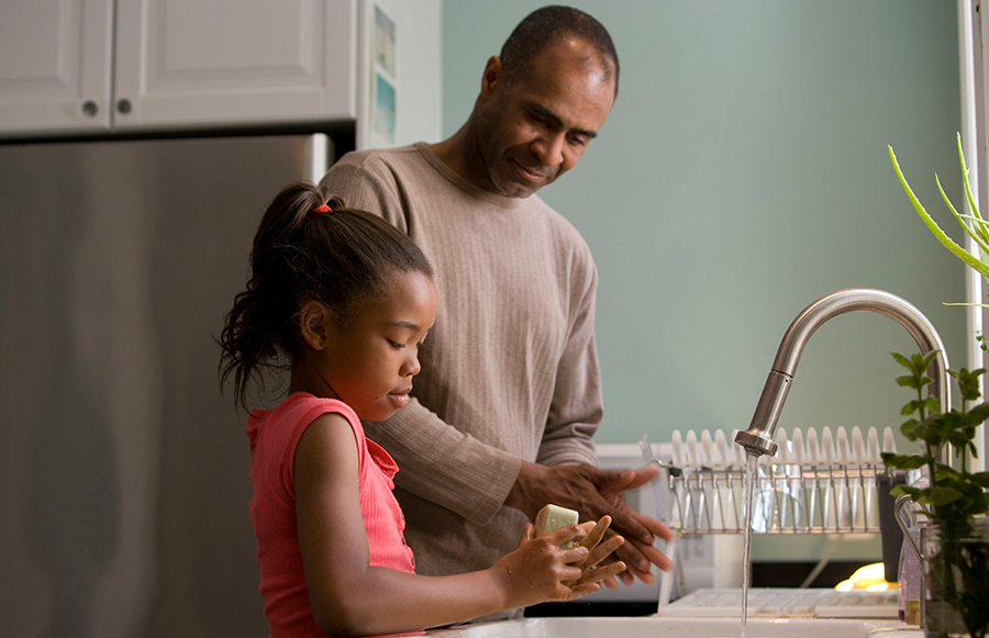Father and Daughter washing hands together