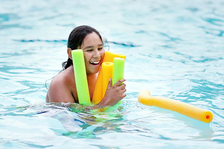 Kid at camp having fun in the pool